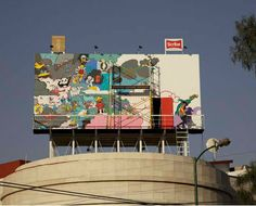 In Mexico City the concept of subverting billboard messages into meaningful art installations is taken even further: hidden behind it's face is a tiny living space for the working artist, complete with bathroom, kitchen and even a small rooftop terrace - the urban art project is a collaboration between paper company Scribe and architect Julio Gomez Trevilla.