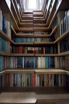 Levitate Architects of London designed this bookshelf staircase to combine storage space with access to a loft bedroom. The skylight above provides enough daylight to read a book while you sit on the stairs!    Read the full text here: http://www.mentalfloss.com/blogs/archives/17063#ixzz1X8DeXpJx  --brought to you by mental_floss!