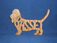 Hey, I found this really awesome Etsy listing at https://www.etsy.com/listing/73182749/basset-hound-dog-breed-scroll-saw-wooden