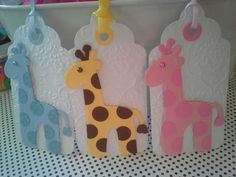 Giraffe baby shower tags handmade scrapbooking embellishments for baby party decor or gift bags. In yellow, light blue and light pink,  from dalayney on chucklesandcharms on etsy.