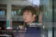 ストックフォト : Young man looking out of the window