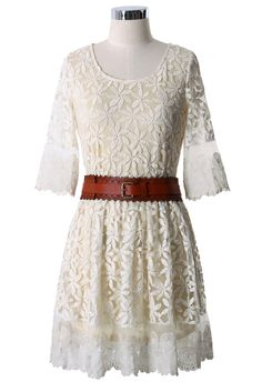 So cute for a music festival or concert! The floral crochet details are really sweet. Full Crochet Floral Dress with Brown Belt
