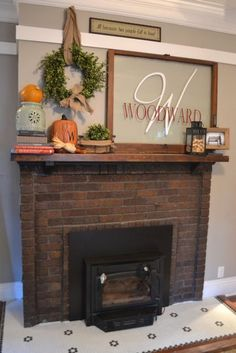 A simple fall mantel with pumpkins and boxwood