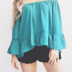 • Carli Off the Shoulder Top • Gorgeous off the shoulder top in a beautiful teal color. 100% Polyester. *Modeling size Small*  ☑️ NO trades. Price is FIRM unless bundled. ☑️ Sizes Available: Small (ONE left), Medium, and Large.  *Black shorts are also available for purchase* Tops Blouses