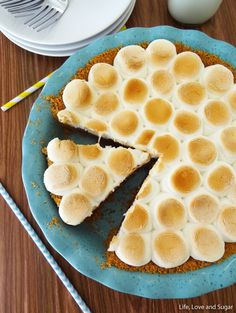 Smores Chocolate Pie by Life, Love and Sugar. This Smores Chocolate Pie is a wonderful, addicting blend of graham cracker and chocolate, piled high with marshmallows. And it's nice and easy to make – very similar to my No Bake Nutella, Peanut Butter and Marshmallow Pie (one of my favorites!), if you've ever made that.