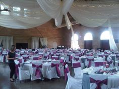 Ivory ceiling draping, Ivory chair covers with hot pink organza sashes and charcoal satin sashes at Harriet Island Pavillion by Deckci Decor