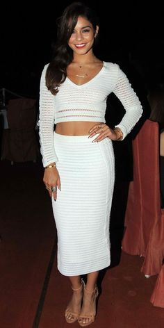 ea1f8e34 Look of the Day › July 2013 WHAT SHE WORE The crop top queen Hudgens bared  her abs in a Catherine Malandrino knit sweater and matching midi skirt.