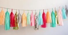 Confetti System Tassel Garland-Bright Multicolor $130   @Jennifer Hicks I think this is what the Geronimo balloons are often shown with in pix....