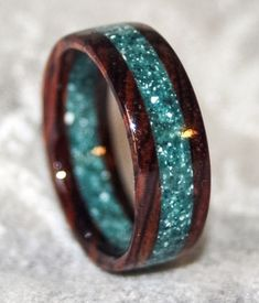 Non-traditional wedding band made from Cocobolo Rosewood & blue-green Corian | MnMWoodworks via Etsy