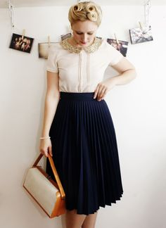 Sequin collar blouse with deep blue pleated skirt.