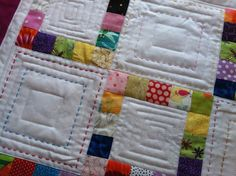 Beautiful idea for hand quilting to fill in negative space on a quilt. Lovely with the variation of colour and design.