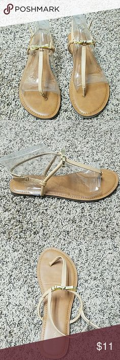 Merona Women's Haley Metallic Bow Sandals in Tan These pre-loved cute sandals woyld be tje perfect addition to your favorite outfit. Yhe best part is tje beautiful gold metallic bow accent. They have been worn once and kept in a box. omfortable and cute sandals have been worn once and kept in a box. Merona Shoes Sandals