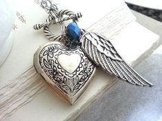 Hey, I found this really awesome Etsy listing at https://www.etsy.com/listing/192735243/silver-heart-locket-silver-angel-wing