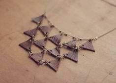 Little Projectiles: Leather Triangle Necklace - made this symphony of triangles necklace from a little piece of scrap distressed leather and a handful of jump rings.