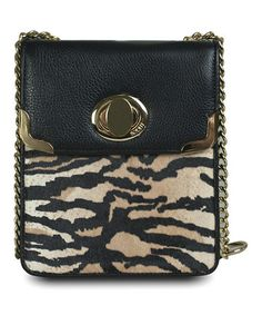 Take a look at this Black & White Jungle Fur Isabella Shoulder Bag by BODHI on #zulily today! $100 !!