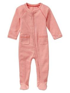 The zipper suits are THE BEST! The footed zip ones and onesie with pants are the only things next one will wear, best PJs for after swaddle. Carters brand are not as soft as baby gap!   Striped footed zip one-piece   Gap