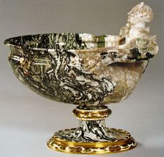 The Triton cup made by Ottavio around 1600 in moss agate from Kozakov in Northern Bohemia (17cm high, 18cm long and 14cm wide) showing how he adroitly exploited the variety of colours available and evolved to a softer and less stereotype cup form. From the collection of Rudolf II and now in the KHM in Vienna