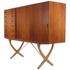 Danish Modern Teak and Oak Cabinet Designed by Hans Wegner | From a unique collection of antique and modern cabinets at https://www.1stdibs.com/furniture/storage-case-pieces/cabinets/