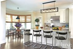 White Traditional Kitchen with Breakfast Bar | LuxeSource | Luxe Magazine - The Luxury Home Redefined