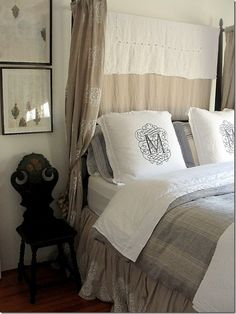 I like the drape behind the headboard and the monogrammed pillows oh, and the LINEN!