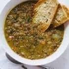 Lentil Soup  4 cloves Garlic 1 Yellow Onion 4 Carrot(s) 4 stalks Celery 3 tbsp Olive Oil 2 cup Lentils 1 tbsp Cumin 2 qt Vegetable Broth 1 Bay Leaf 2 whole sprigs Thyme Salt and Pepper to taste