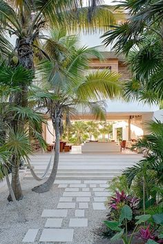 This private beachfront villa in Tulum, Mexico is a fully self-sufficient, net-neutral house powered by a photovoltaic canopy on its rooftop terrace, and collects rainwater that is filtered and stored for use. Indoor Outdoor, Outdoor Living, Outdoor Decor, Tulum Mexico, Eco Friendly House, Tropical Houses, Tropical Gardens, Modern Tropical, Tropical Landscaping