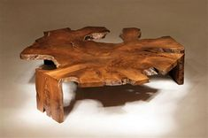 http://static.designlike.com/wp-content/uploads/2011/10/Single-Contemporary-Coffee-Table-with-Rustic-Style.jpg
