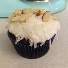 Almond Joy cupcakes with chocolate cake, coconut frosting, dipped in sweetened dried coconut and finished with sliced almonds. Delish.