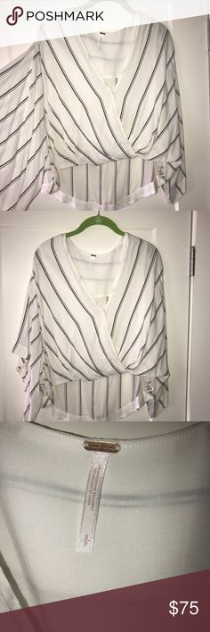 Free People Blouse Black and white striped blouse with billowing sleeves! Never worn! Free People Tops Blouses