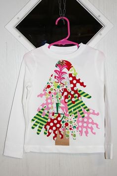 No Sew Christmas Tree shirt.  Had wonderful results with this one.  I traced both right and left hands so the thumbs pointed out on each side.  I also traced her hand over and over so each one is a little different.  And we cut a star from yellow fabric for the top.  Great project, lots of fun to do together.