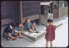 Vintage Japanese photograph. Children in street.