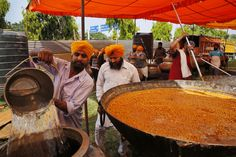 Indian Sikhs prepare food for devotees at a Sikh temple on Baisakhi, in New Delhi, India, Tuesday, April 14, 2015.