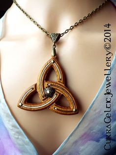 """033 Celtic Triquetra in Iroko with gold wire 2"""" round"""