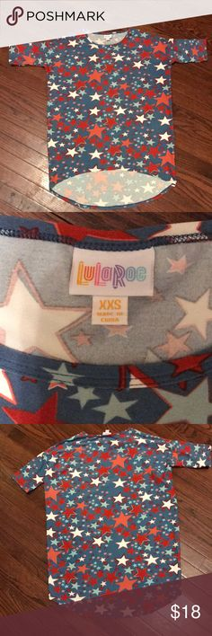 LuLaRoe XXS Irma in red white blue stars LuLaRoe size XXS Irma in red/white/blue star pattern.  Worn very few amount of times and always washed per LLR instructions. LuLaRoe Tops