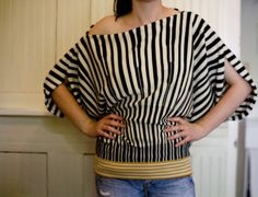 flip a skirt around and make a funky new top in 30 mins or less.  Love this idea!