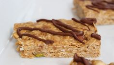No Bake Nut Lover's Bars are a combination of smooth peanut butter and chopped nuts, packed with healthy fats and protein, and topped with a drizzle of hazelnut spread. Healthy Protein Snacks, Protein Bar Recipes, Protein Powder Recipes, Healthy Fats, Nutritious Snacks, Healthy Eating, Chocolate Protein Bars, Chocolate Recipes, Best Dessert Recipes