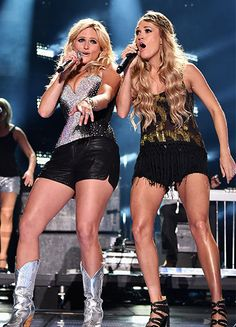 Getting Leggy! Miranda Lambert and Carrie Underwood showed some skin as they performed together onstage at the CMA Festival in Nashville, Te...