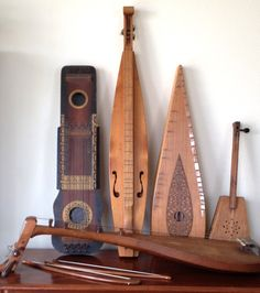 From left to right: a ukelin, a mountain dulcimer, a bowed psaltery,  a diddley-bow, and in front is a biwa.