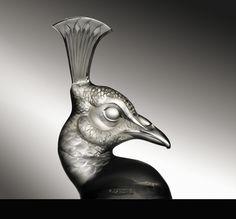 Hood Ornaments, LALIQUE AUTOMOBILE MASCOTS, 1932 / Tete De Paon (Photo Credit Courtesy of RM Auctions)