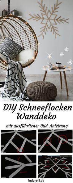 DIY winterliche weihnachtliche Wanddeko Schneeflocke aus Eisstielen Holzspatel