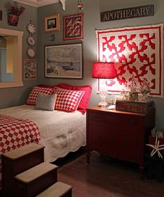 Very cozy comfortable room. I like the quilts & the red against the greyish walls. I don't like beds shoved in a corner unless you can't help it though.