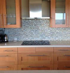 Cabinets: IKEA ADEL Beech Counter: Caesarstone Dreamy Marfil Backsplash: Walker Zanger Waterfall. Rain pattern. Color--Moss/Oyster/Onyx