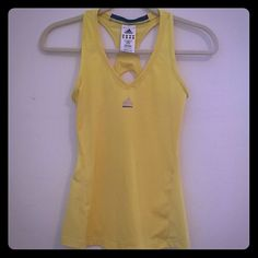 Activewear Tank Adidas sports tank.  NO built-in support.  V-neck. Great condition!  Pet-free, Smoke-free home. Adidas Tops Tank Tops
