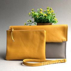 Yellow and gray leather fold over clutch