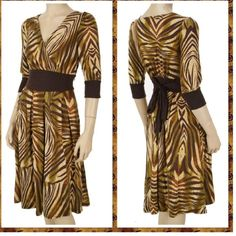 WILD SAFARI SURPLICE FRONT DRESS - LARGE Available in three different colors, long sleeve, V-Neck with stretchable waist and long sleeve cuffs; Safari accent print. Shell 100% polyester.  S-M-L. Available in black, brown, grey.   S (2-4) M (6-8) L( 10-12). This listing is for the BROWN and in LARGE Ryu Dresses