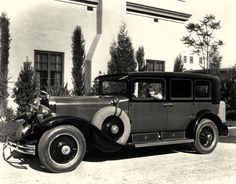 """""""Clara Bow looks adorable as she poses in her Cadillac Sedan in front of her luxurious Los Angeles home.""""  (via My Love of Old Hollywood)"""