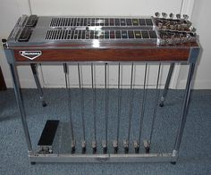 """Pedal steel guitars may have one or two """"necks"""" that typically have 10 strings each, but may have as many as 14. Unlike most other guitars, pedal steel guitars have reference lines on the fretboard where frets would be, but no actual frets. The player changes the pitch of one or more strings by sliding a metal bar (a steel) from one position to another while plucking the strings with the other hand, or vibrating them with a mechanical device."""