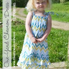 One Yard Chevron Dress Tutorial by The DIY Mommy. This sweet summer dress with tied should straps and a double ruffle hem uses only one yard of fabric or less. Easy & cute! #kids #clothing #DIY #sewing