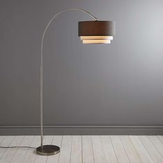 Featuring an arched design and a chrome coated metal stem, this grey floor lamp features a lamp shade with a tiered form in a linen effect. Bronze Floor Lamp, Arc Floor Lamps, Desk Lamp, Table Lamp, Interior Design Courses, I Love Lamp, Standard Lamps, Grey Flooring, Soft Furnishings