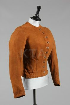 A rare chamois leather lady's riding jacket or under-jacket, 1890s, lined in pale blue silk with brown-stained mother of pearl buttons, bust...